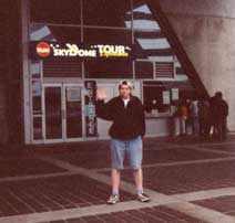 Byron waving in front of the Skydome in Toronto