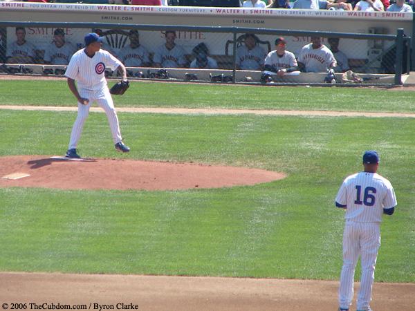 Angel Guzman pitches as Aramis Ramirez looks on