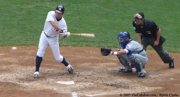 Johnny Damon swings at a strike