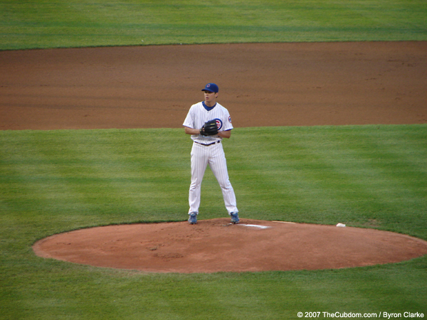 Rich Hill throws a pitch