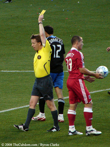 Andrew Chapin awards a yellow card