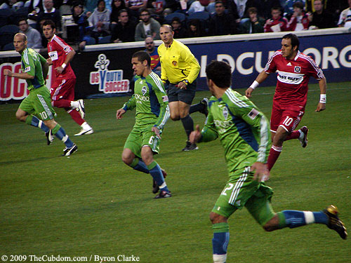 Fire attackers and Sounders defensemen run in transition.